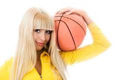 Beautiful girl with a ball. Beautiful blond girl with a basketball ball isolated against white background stock images