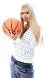 Beautiful girl with a ball. Beautiful girl with a basketball ball isolated against white background royalty free stock photo