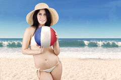 Beautiful girl with a ball on the beach Royalty Free Stock Photo
