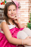 Beautiful girl in ball dress by fireplace. Christmas Royalty Free Stock Photos