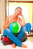 Beautiful girl with a ball and a suitcase Royalty Free Stock Photo