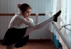 Girl ballet dancer practicing on the barre Royalty Free Stock Photos