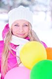 Beautiful girl with balloons. Winter girl with the many-colored balloons Royalty Free Stock Photo