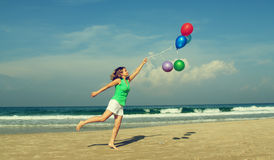 Beautiful girl with a balloons on the beach stock photography