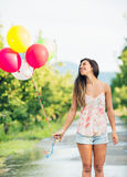 Beautiful Girl with Balloons. Beautiful Happy Girl Holding Balloons Royalty Free Stock Photo