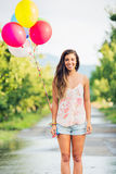 Beautiful Girl with Balloons. Beautiful Happy Girl Holding Balloons Royalty Free Stock Images