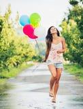 Beautiful Girl with Balloons. Beautiful Happy Girl Holding Balloons Stock Image