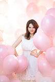 Beautiful girl in balloons stock image