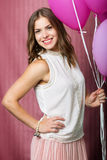 Beautiful girl with balloons Stock Images