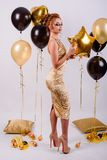 Girl with balloons in the studio Stock Image