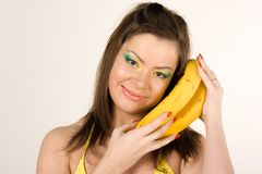 Beautiful girl with banana Royalty Free Stock Photography