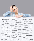 Beautiful girl with a banner of world's different languages royalty free stock image