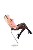 Beautiful girl and bar chair Stock Photo