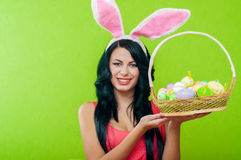 Beautiful girl with a basket of Easter eggs i Royalty Free Stock Images
