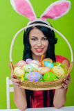 Beautiful girl with a basket of Easter eggs i Stock Photos