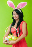 Beautiful girl with a basket of Easter eggs i Royalty Free Stock Photo