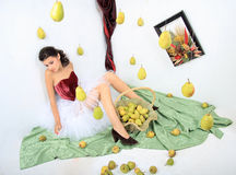 Beautiful girl with a basket of pears Stock Images