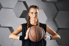 Beautiful girl with a basketball Stock Images