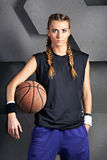 Beautiful girl with a basketball Stock Photography