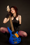 Beautiful girl with bass guitar Royalty Free Stock Photo