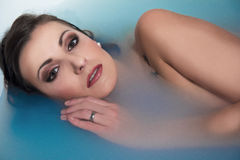 The beautiful girl in the bath Royalty Free Stock Photo