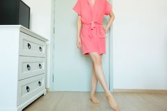Beautiful Girl In Bath Robe. Beautiful Woman Model In Pink Robe. Portrait Female In Pink Pajamas Fashion In Home Interior. Background Stock Photography