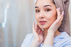 Beautiful girl after bath touching her face. Perfect skin, skincare. Beautiful woman after bath touching her face. Perfect skin, skincare, Spa royalty free stock images