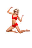 Beautiful girl in a bathing suit jumped on a white background Stock Images