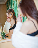 Beautiful girl in a bathrobe Stock Images