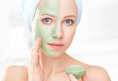 Beautiful girl in bathroom and mask for facial skin care Royalty Free Stock Images