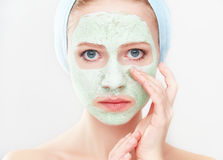 Beautiful girl in  bathroom and mask for facial skin care Stock Photos