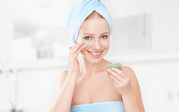 Beautiful girl in  bathroom and mask for facial skin care Stock Photography