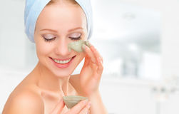 Beautiful girl in bathroom and mask for facial skin care Royalty Free Stock Photo