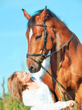 Beautiful  girl  with bay  horse Stock Image