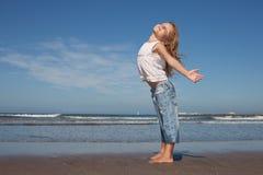 Beautiful girl on the beach. Cute little girl enjoying the sun on the beach Royalty Free Stock Images