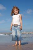 Beautiful girl on the beach. Beautiful little girl on the beach smiling Stock Image