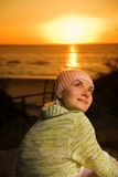 Beautiful girl on the beach. At sunset time Royalty Free Stock Photo