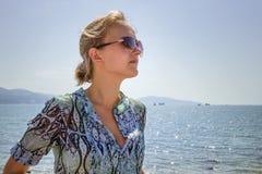 Beautiful girl on the beach alone Stock Photos