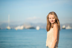 Beautiful girl on the beach in Cannes, France Royalty Free Stock Image