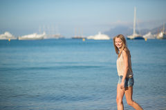 Beautiful girl on the beach in Cannes, France Royalty Free Stock Photos