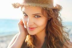 Beautiful girl on a beach. Beautiful girl close up portrait. Outdoor shoot Stock Photography