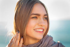 Beautiful girl on a beach. Beautiful girl close up portrait. Outdoor shoot Stock Photos