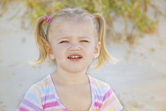 Beautiful girl on a beach on the coast. Playing with the sand Royalty Free Stock Photo