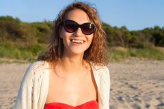Beautiful girl on a beach. Beautiful curly girl is smiling. Outdoor shoot Royalty Free Stock Photos