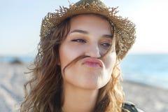 Beautiful girl on a beach is kidding. Beautiful girl close up portrait. Outdoor shoot Stock Photos