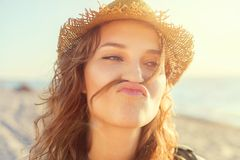 Beautiful girl on a beach is kidding. Beautiful girl close up portrait. Outdoor shoot Royalty Free Stock Images