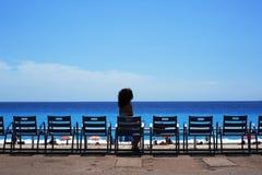 Beautiful girl on the beach in Nice Stock Photography