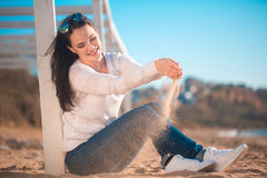 Beautiful girl on the beach Stock Image