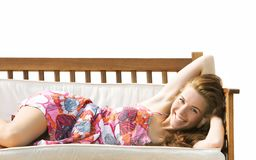 Beautiful girl on beach sofa over white Stock Photography