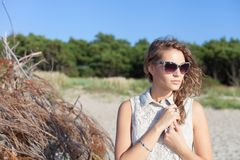 Beautiful girl on a beach. Beautiful girl in sunglasses on a beach. Outdoor shoot Royalty Free Stock Photography